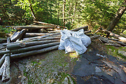 Resolution Shelter Removal Project White Mountains, NH - The Resolution shelter, located in the Dry River Wilderness, was closed in 2009 because of safety issues. The shelter was dismantled in December 2011 and volunteers will remove selected debris (asphalt shingles), scatter the logs throughout the area, and then the site will be rehabilitated. This is how the site looked in July 2012. This is a work in progress.
