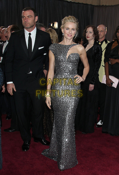 Liev Schreiber & Naomi Watts (wearing Armani Prive).85th Annual Academy Awards held at the Dolby Theatre at Hollywood & Highland Center, Hollywood, California, USA..February 24th, 2013.oscars full length gunmetal grey gray sequins asymmetrical sequined liquid glittering gown with cutout neckline stubble facial hair hand on hip dress metallic black suit couple .CAP/ADM/RE.©Russ Elliot/AdMedia/Capital Pictures.