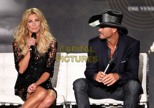 Faith Hill & Tim McGraw.Country Music Superstars Tim McGraw and Faith Hill join The Venetian Las Vegas in announcing an all-new SOUL2SOUL coming to the Venetian, Las Vegas, Nevada, USA..August 7th, 2012.half length black lace dress microphone profile sitting hat jacket jeans denim married husband wife .CAP/ADM/MJT.© MJT/AdMedia/Capital Pictures.