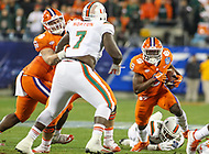 Charlotte, NC - December 2, 2017: Clemson Tigers running back Travis Etienne (9) runs the ball during the ACC championship game between Miami and Clemson at Bank of America Stadium in Charlotte, NC.  (Photo by Elliott Brown/Media Images International) Clemson defeated Miami 38-3 for their third consecutive championship title.