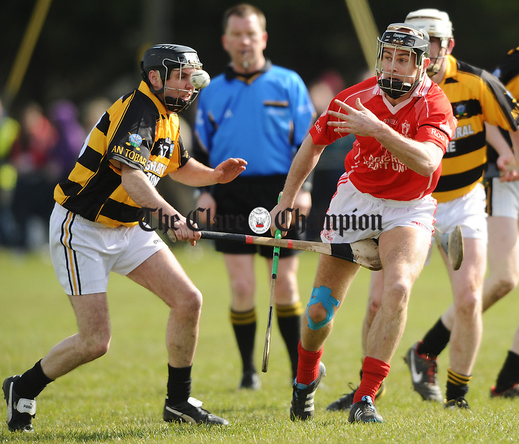 Oliver Taaffe of Tubber in action against Aaron Ryan of Roscrea during the All-Ireland Junior B Hurling Championship Final at Raheenagh, Limerick. Photograph by John Kelly.