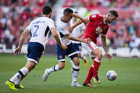 Barrie McKay of Nottingham Forest holds off Shaun Williams and Conor McLaughlin of Millwall during the Sky Bet Championship match between Nottingham Forest and Millwall at the City Ground, Nottingham, England on 4 August 2017. Photo by James Williamson / PRiME Media Images.
