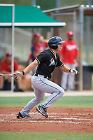 GCL Marlins designated hitter Michael Donadio (24) follows through on a swing during the second game of a doubleheader against the GCL Nationals on July 23, 2017 at Roger Dean Stadium Complex in Jupiter, Florida.  GCL Nationals defeated the GCL Marlins 1-0.  (Mike Janes/Four Seam Images)