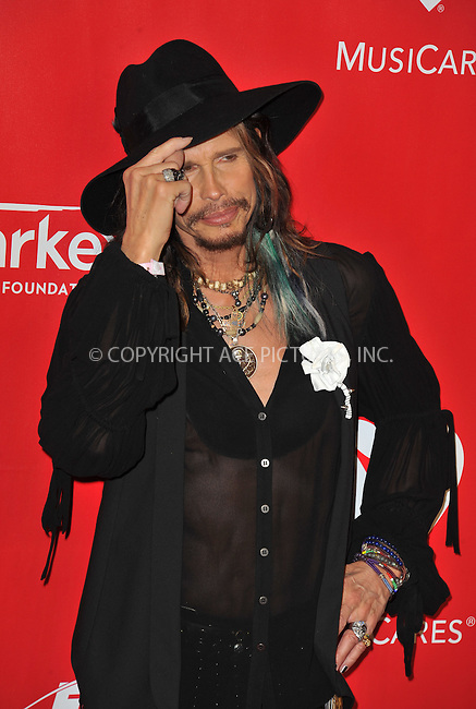 WWW.ACEPIXS.COM<br /> <br /> January 24 2014, LA<br /> <br /> Steven Tyler arriving at The 2014 MusiCares Person Of The Year Gala Honoring Carole King at the Los Angeles Convention Center on January 24, 2014 in Los Angeles, California.<br /> <br /> By Line: Peter West/ACE Pictures<br /> <br /> <br /> ACE Pictures, Inc.<br /> tel: 646 769 0430<br /> Email: info@acepixs.com<br /> www.acepixs.com