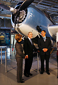 New York, NY - November 11, 2008 -- First lady Laura Bush, United States President George W. Bush and Eric Boehm stand in front of a TBM Avenger aircraft on Veteran's Day at the rededication ceremony of the Intrepid Sea, Air and Space Museum in New York City on Tuesday, November 11, 2008.  <br /> Credit: John Angelillo - Pool via CNP