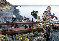 Hunters enjoy a beer near the shore in Cold Bay, Alaska, Friday, November 4, 2016. The Izembek National Wildlife Refuge lies on the northwest coastal side of central Aleutians East Borough along the Bering Sea and Cold Bay. Birds hunted include the long tailed duck, the Steller's Eider, the Harlequin, the King Eider and Brant.<br /> <br /> <br /> Photo by Matt Nager