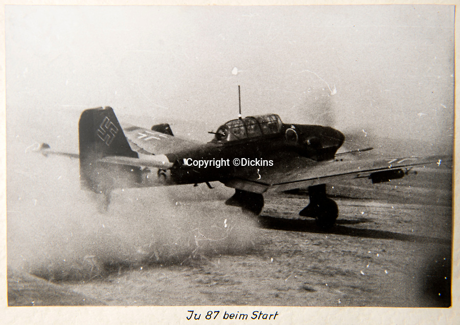 BNPS.co.uk (01202 558833)<br /> Pic: Dickins/BNPS<br /> <br /> Operation Barbarossa - Starting a JU 87 Stuka - Richthofen is thought to have designed the notorious 'Jericho trumpet' siren of the dive bomber.<br /> <br /> The unseen personal photo album of Field Marshal Wolfram von Richthofen, cousin to the legendary Red Baron, which gives an unprecedented insight into his military career in the Third Reich, has been rediscovered.<br /> <br /> Wolfram served in the Red Baron's squadron in the WW1, went on to design the 'Jericho trumpet' of the infamous Stuka Bomber between the wars, before leading the Condor Legion in the Spanish Civil War.<br /> <br /> After the outbreak of WW2 the fascinating album shows Richthofen's lead roll in Operation Barbarossa - the Nazi's suprise invasion of Communist Russia and their race to conquer the vast country before the onset of the notorious Russian winter.<br /> <br /> The two albums were taken from Berlin by a British soldier at the end of the Second World War who kept it for 60 years before it was passed into the hands of a private collector.<br /> <br /> Dickins auctions are selling the historic albums with a £20,000 estimate on 31st March.
