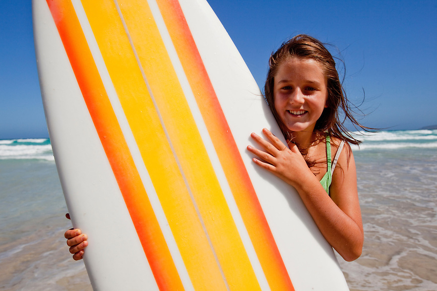 Girl holding retro surfboard