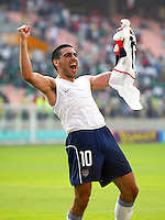 Claudio Reyna celebrates the USA's 2-0 win over Mexico in the second round in Jeonju, Soth Korea, Monday June 17, 2002.