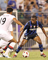Samuel Eto'o #9 of Inter Milan cuts away from Jolson Lescott of Manchester City during an international friendly match on July 31 2010 at M&T Bank Stadium in Baltimore, Maryland. Milan won 3-0.