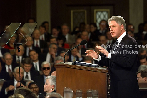 """United States President Bill Clinton delivers the State of the Union Address before a Joint Session of Congress in Washington, D.C. on January 19, 1999.   Clinton said, """"I stand before you to report that the state of our union is strong.""""                                                                     .Credit: Win McNamee / Pool via CNP"""