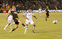 Columbus Crew forward Steven Lenhart (32) takes a shot on goal past Galaxy defender Leonardo (22) during the first half of the game between LA Galaxy and the Columbus Crew at the Home Depot Center in Carson, CA, on September 11, 2010. LA Galaxy 3, Columbus Crew 1.