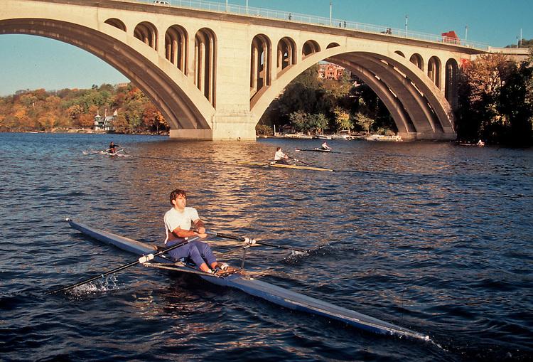 Rowing, Washington DC, Potomac Boat Club single scullers in sinlge racing shells, appraoching the Key Bridge on the Potomac River, .