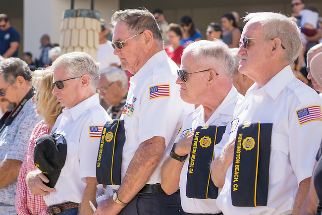 (left to right)Russ Dohrmann, Norm Sumner, George Focht and Dennis Bronson hold their hats over their hearts during the benediction by Chaplain Bob Ewing at the end of the 9/11 service in Huntington Beach.<br /> <br /> ///ADDITIONAL INFORMATION: hb.0915.memorial – 9/11/16 – MICHAEL KITADA, ORANGE COUNTY REGISTER - _DSC9416.jpg - <br /> Summary: The Huntington Beach Police Officers' Foundation's 9-11 Memorial Committee unveils a $200,000 monument including steel from the toppled World Trade Center, at City Hall. The event will include music, a flyover, New York police and others with connections to the 9-11 rescue and victims of the tragedy.