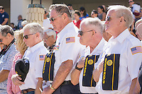 (left to right)Russ Dohrmann, Norm Sumner, George Focht and Dennis Bronson hold their hats over their hearts during the benediction by Chaplain Bob Ewing at the end of the 9/11 service in Huntington Beach.<br /> <br /> ///ADDITIONAL INFORMATION: hb.0915.memorial &ndash; 9/11/16 &ndash; MICHAEL KITADA, ORANGE COUNTY REGISTER - _DSC9416.jpg - <br /> Summary: The Huntington Beach Police Officers' Foundation's 9-11 Memorial Committee unveils a $200,000 monument including steel from the toppled World Trade Center, at City Hall. The event will include music, a flyover, New York police and others with connections to the 9-11 rescue and victims of the tragedy.