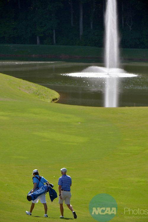 20 MAY 2015:  Mateo Gomez of Lynn University and his coach walk along the 16th fairway during the Division II Men's Individual Golf Championship held at the Rock Barn Golf & Spa in Conover, NC. Grant Halverson/NCAA Photos