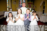 Pupils from Scoil Míchíl Naofa Ballinskelligs making their First Holy Communion in St Michaels Church Dun Gagan on Sunday last were l-r; Jessica Nic an Ghaill, Rebecca Ní Shé, Fr. David Gunn, Luke O Catháin agus Robyn Ní Churnáin.