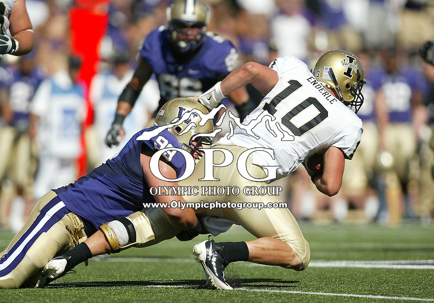 Sep 12, 2009:  Washington defensive tackle #99 Cameron Elisara brings down Idaho quarterback #10 Nathan Enderle for a sack of a nine yard loss.  Washington defeated the Idaho Vandals 42-23 at Husky Stadium in Seattle, Washington..
