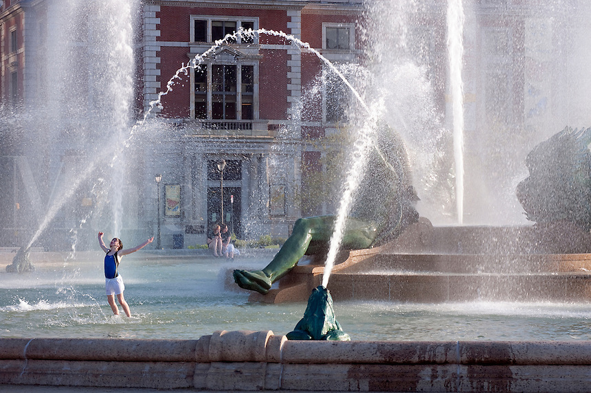 Girl playing in Swann Fountain in Logan's Circle, Philadelphia, Pennsylvania