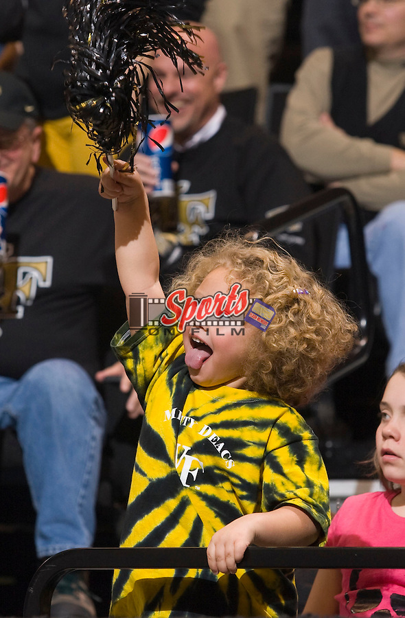 A young Wake Forest Demon Deacons fan waves her pom-pom during second half action against the North Carolina State Wolfpack at the Lawrence Joel Veterans Memorial Coliseum December 20, 2009, in Winston-Salem, North Carolina.  Photo by Brian Westerholt / Sports On Film