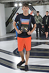 Model Jannik poses in a collage t-shirt in navy, and cupro short in safety, from the Perry Ellis Spring 2017 collection by Michael Maccari, on July 11th 2017, during New York Fashion Week Men's Spring Summer 2017.
