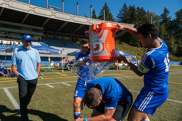 September 4, 2016:  UBC head coach Mike Mosher avoids a water bath after earning his 200th career conference and playoff men's soccer victory. The University of British Columbia Thunderbirds defeated the University of Northern British Columbia Timberwolves 3-1 at Thunderbird Stadium, University of British Columbia, Vancouver, BC, Canada.<br /> <br /> ****(Photo by Wilson Wong/UBC Thunderbirds 2016 All Rights Reserved****