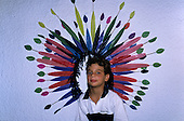 Rio de Janeiro, Brazil. Carnival: boy posing in front of a painted headdress.
