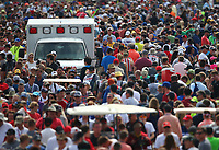 May 28, 2017; Indianapolis, IN, USA; An emergency ambulance makes its way through crowds of IndyCar Series fans in the infield during the 101st Running of the Indianapolis 500 at Indianapolis Motor Speedway. Mandatory Credit: Mark J. Rebilas-USA TODAY Sports
