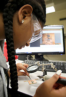 NWA Democrat-Gazette/DAVID GOTTSCHALK  Madison Golphin (cq), from Fort Valley, GA., solders Wednesday, June 14, 2017, components to a circuit board while participating in  the seven day Math, Science, Engineering Academy at the University of Arkansas in Fayetteville. The high school age students were building a solar paneled cell phone charger. The camp emphasizes the science, technology, engineering and mathematics fields.
