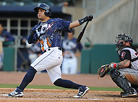 NWA Democrat-Gazette/ANDY SHUPE<br /> Northwest Arkansas Naturals catcher Luis Villegas connects for an RBI double Saturday, June 10, 2017, during the fifth inning against the Arkansas Travelers at Arvest Ballpark in Springdale. Visit nwadg.com/photos to see more photographs from the game.