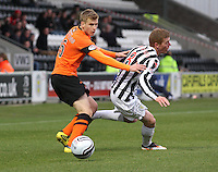 Stuart Armstrong and Jon Robertson challenge in the St Mirren v Dundee United Clydesdale Bank Scottish Premier League match played at St Mirren Park, Paisley on 27.10.12.