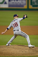 Auburn Tigers pitcher Daniel Koger #18 delivers a pitch to the plate against the LSU Tigers in the NCAA baseball game on March 22nd, 2013 at Alex Box Stadium in Baton Rouge, Louisiana. LSU defeated Auburn 9-4. (Andrew Woolley/Four Seam Images).