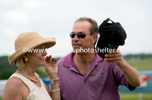Trainer Billy Meister gives a tip of the cap to owner Diane Naylor after Wolfe Tone wins the 8th race timber allowance at Fair Hill.