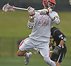 Sean Lulley #33 of Hills East takes a shot and scores the opening goal of the game in the first quarter of the Suffolk County varsity boys lacrosse Division I (Class A) quarterfinals against Commack at Half Hollow Hills High School East on Friday, May 19, 2017. He scored three goals in Hills East's 11-9 win.