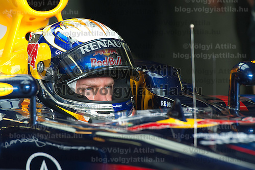 Red Bull Racing Formula One driver Mark Webber of Australia sits in his car during the free practice session of the Hungarian F1 Grand Prix in Mogyorod (about 20km north-east from Budapest), Hungary. Thursday, 28. July 2011. ATTILA VOLGYI