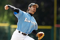 14 July 2011: Starting pitcher Samuel Meurant of Senart Templiers pitches against Pessac during the 2011 Challenge de France match won 12-9 by the Senart Templiers over Pessac Pantheres, at Stade Pierre Rolland, in Rouen, France.
