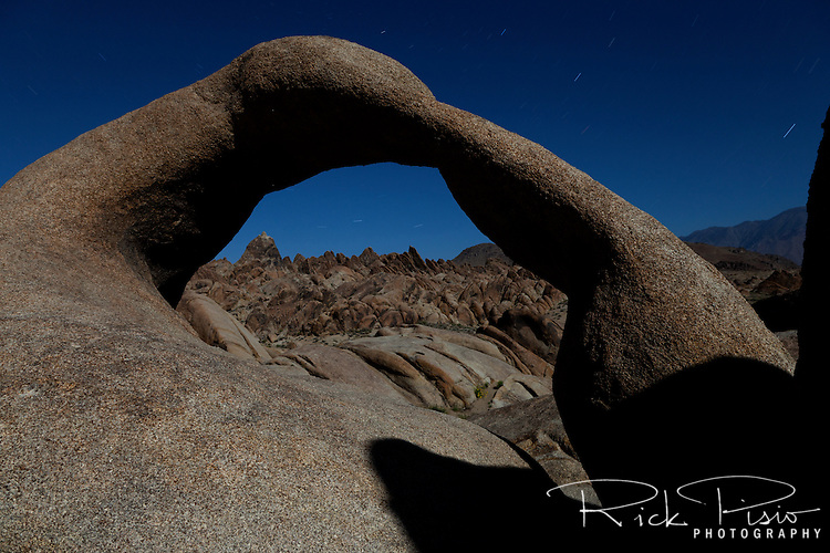 "Mobius Arch, in California's Alabama Hills State Recreation Area forms a portal to view of the nearby terrain. Since the 1920's film makers have been using the Alabama Hills as a backdrop for their movies. In the early days of motion pictures films such as ""Gunga Din"", ""How the West Was Won"", and ""Yellow Sky"" were filmed at a site within the recreation area known as ""Movie Flats. More recently movies such as ""Tremors"", ""Star Trek Generations,"" ""Gladiator"", ""Iron Man"", and ""Django Unchained"" were shot in the Alabama Hills."