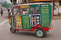 Daytime landscape view of an enclosed taxi scooter in Píngyáo Shì of the Jìnzhōng District in Shānxī Province, China  © LAN