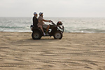 Couple riding a Quad on the playa near Migrino, Baja California, Mexico