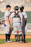 Hagerstown Suns manager Darnell Coles (19) chats with starting pitcher Cole Kimball (45) and catcher Sean Rooney (25) at Fieldcrest Cannon Stadium in Kannapolis, NC, Sunday May 25, 2008.
