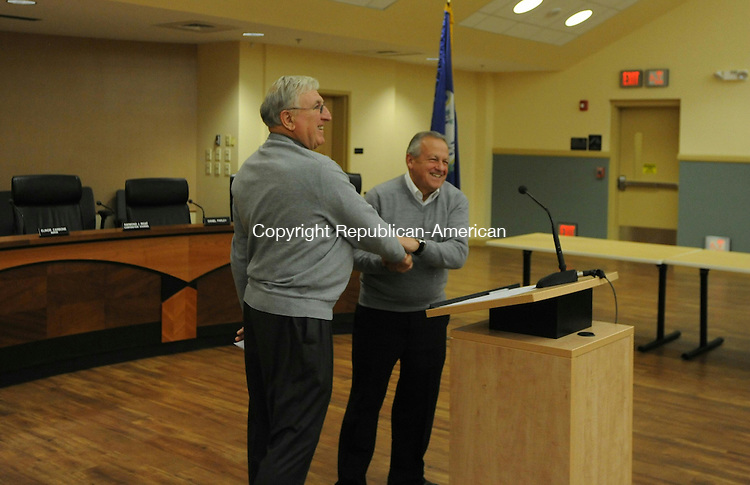"""TORRINGTON, CT- 7 December 2015- 08120715BJ03-- Republican Arthur Mattiello shakes hands with City Clerk Joseph Quartiero after reciting the oath of office for city treasurer on Monday at City Hall.  Mattiello and 21 other residents took the oath of office for various boards and positions, including constables, selectmen, Board of Education, Board of Public Safety, City Council and treasurer. Mayor Elinor Carbone told the city officials the oath is a """"life-changing commitment to the city."""" Bruno Matarazzo Jr. Republican-American"""