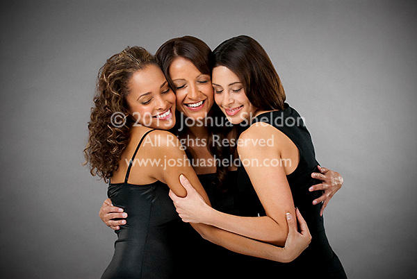 Group of Hispanic women embracing