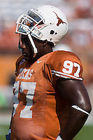 02 September 2006: University of Texas defensive lineman Frank Okam watches his team run practice plays before the Longhorns 56-7 victory over the University of North Texas at Darrell K Royal Memorial Stadium in Austin, TX.