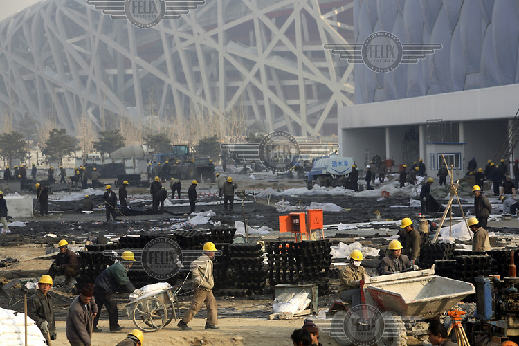 Migrant workers on the 2008 Olympic Games site. The