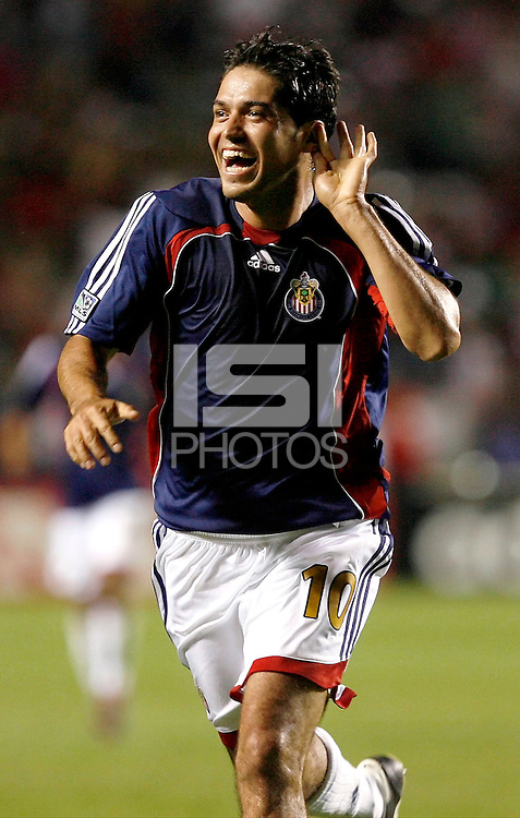 Chivas USA midfielder Juan Pablo Garcia asks to hear it from the crowd after scoring the game's first goal.  Chivas USA defeated the Chicago Fire 2-1 at Toyota Park in Bridgeview, IL on August 12, 2006.