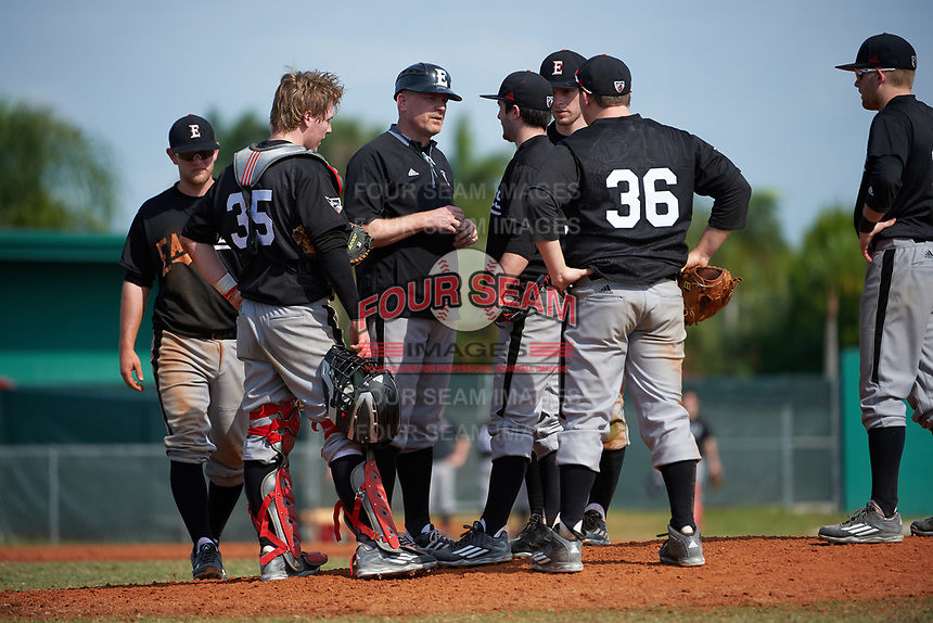 Edgewood Eagles head coach Al Brisack talks with pitcher Bryce Lashley (31) as third baseman Tim Nunn (left), catcher Casey Seelow (35), first baseman Nick Lehner (36) , shortstop Jonathan Roehler (back) and second baseman Nik Visone (right) listen in during the first game of a doubleheader against the Lasell Lasers on April 14, 2016 at Terry Park in Fort Myers, Florida.  Edgewood defeated Lasell 9-7.  (Mike Janes/Four Seam Images)