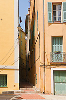 Narrow alleyway and colourful buildings, Menton, France