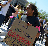 "October 6, 2011  (Washington, DC)  Juan Carlos Reyes holds a sign expressing his views during the first day of ""Occupy DC"". Hundreds of people from around the country descended on Washington for the protest, which has spread from New York City's ""Occupy Wall Street""    (Photo by Don Baxter/Media Images International)"