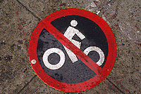 No Bicycling symbol on the sidewalk in Bellingham, Washington, USA....