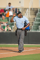 Home plate umpire Christopher Lloyd between innings of the South Atlantic League game between the Delmarva Shorebirds and the Kannapolis Intimidators at CMC-Northeast Stadium on June 7, 2015 in Kannapolis, North Carolina.  The Shorebirds defeated the Intimidators 9-1.  (Brian Westerholt/Four Seam Images)